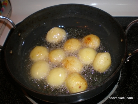 potatoes are being deep fried