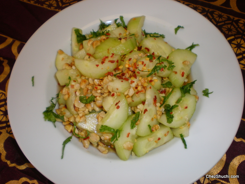 cucumber salad with sweet chili dressing and roasted peanuts