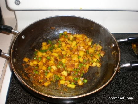 vegetables frying for poha