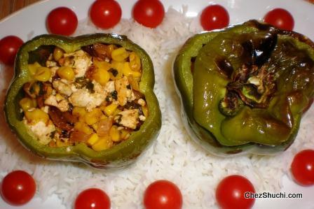 brushing oil on stuffed bell pepper